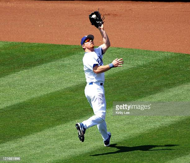 JD Drew of the Los Angeles Dodgers chases down a fly ball during 75 loss to the Arizona Diamondbacks at Dodger Stadium in Los Angeles Calif on...