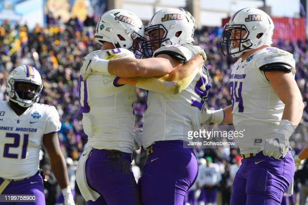Drew Painter of the James Madison Dukes congratulates Riley Stapleton on a touchdown against the North Dakota State Bison during the Division I FCS...