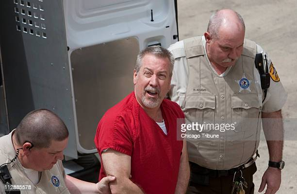 Drew Peterson is escorted on Friday May 8 to the Will County Courthouse for an arraignment hearing in Joliet Illinois Peterson is being charged with...