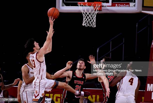 Drew Peterson of the USC Trojans drives to the basket against the Utah Utes In the second half of a NCAA basketball game at Galen Center on the...