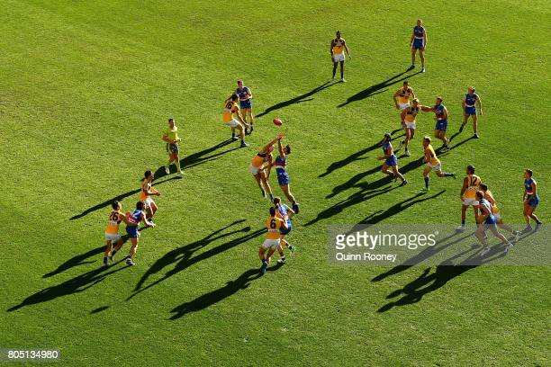 Drew Petrie of the Eagles and Tom Campbell of the Bulldogs compete in the ruck during the round 15 AFL match between the Western Bulldogs and the...