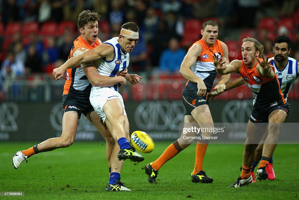 Drew Petrie of the Kanagaroos kicks a goal during the round 12 AFL match between the Greater Western Sydney Giants and the North Melbourne Kangaroos at Spotless Stadium on June 20, 2015 in Sydney, Australia.