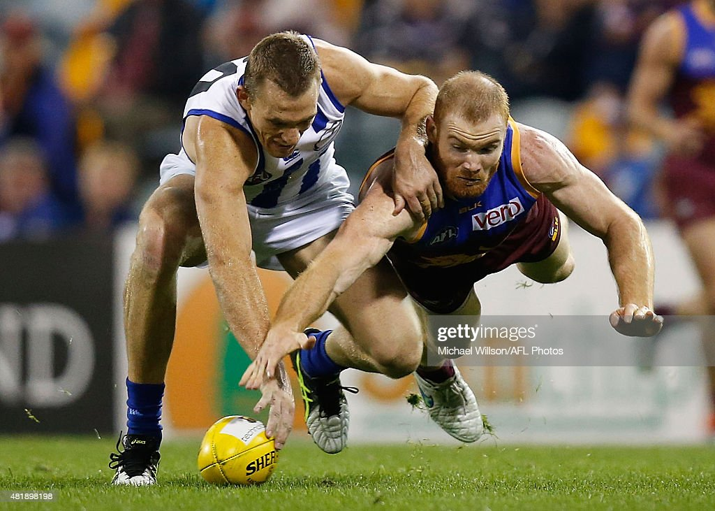 Drew Petrie of the Kangaroos and Daniel Merrett of the Lions in action during the 2015 AFL round 17 match between the Brisbane Lions and the North Melbourne Kangaroos at The Gabba, Brisbane, Australia on July 25, 2015.