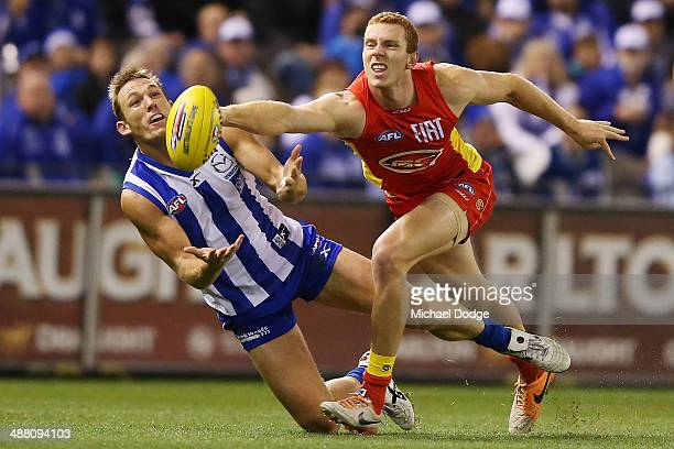 Drew Petrie of the Kangaroos and Rory Thompson of the Suns contest for the ball during the round seven AFL match between the North Melbourne...