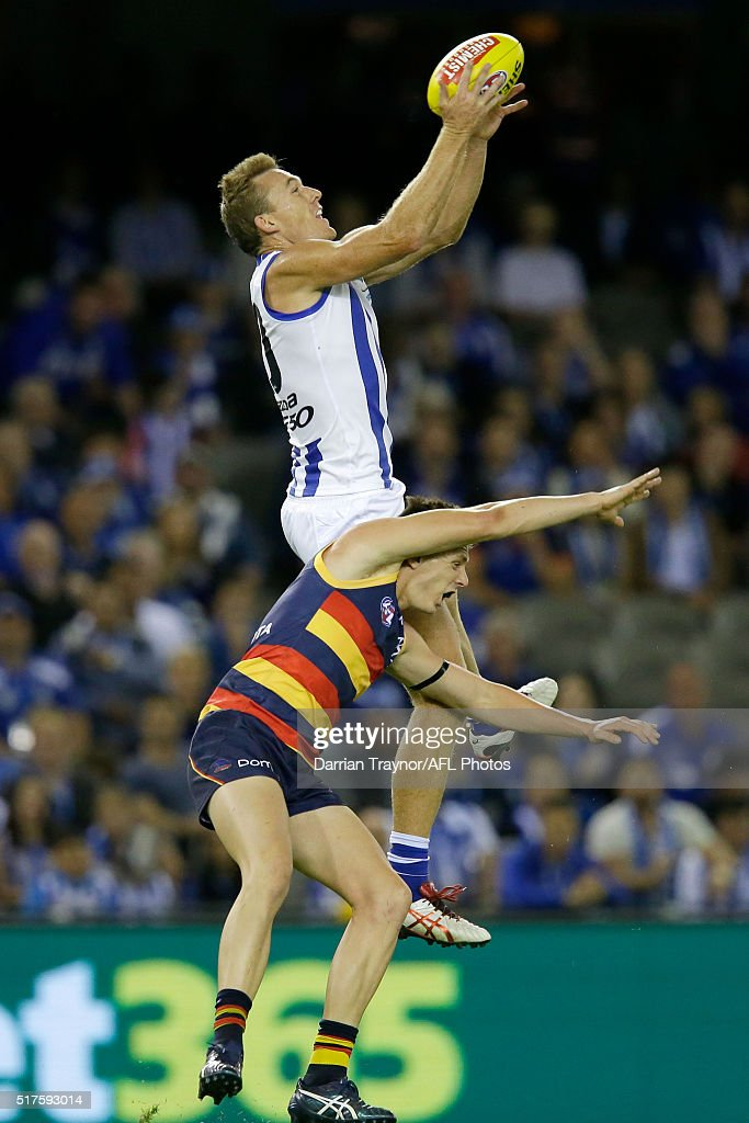 Drew Petrie of the Kangaroos attempts to mark the ball during the round one AFL match between the North Melbourne Kangaroos and the Adelaide Crows at Etihad Stadium on March 26, 2016 in Melbourne, Australia.