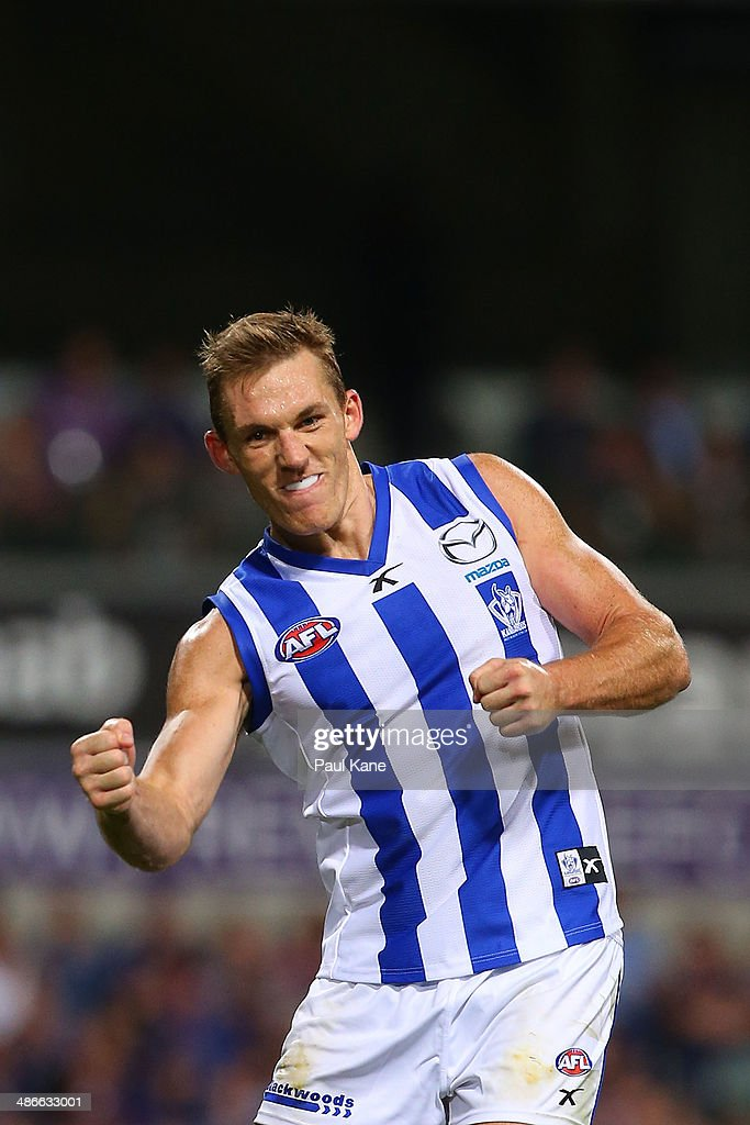 Drew Petrie of the Kangaroos celebrates a goal during the round six AFL match between the Fremantle Dockers and the North Melbourne Kangaroos at Patersons Stadium on April 25, 2014 in Perth, Australia.