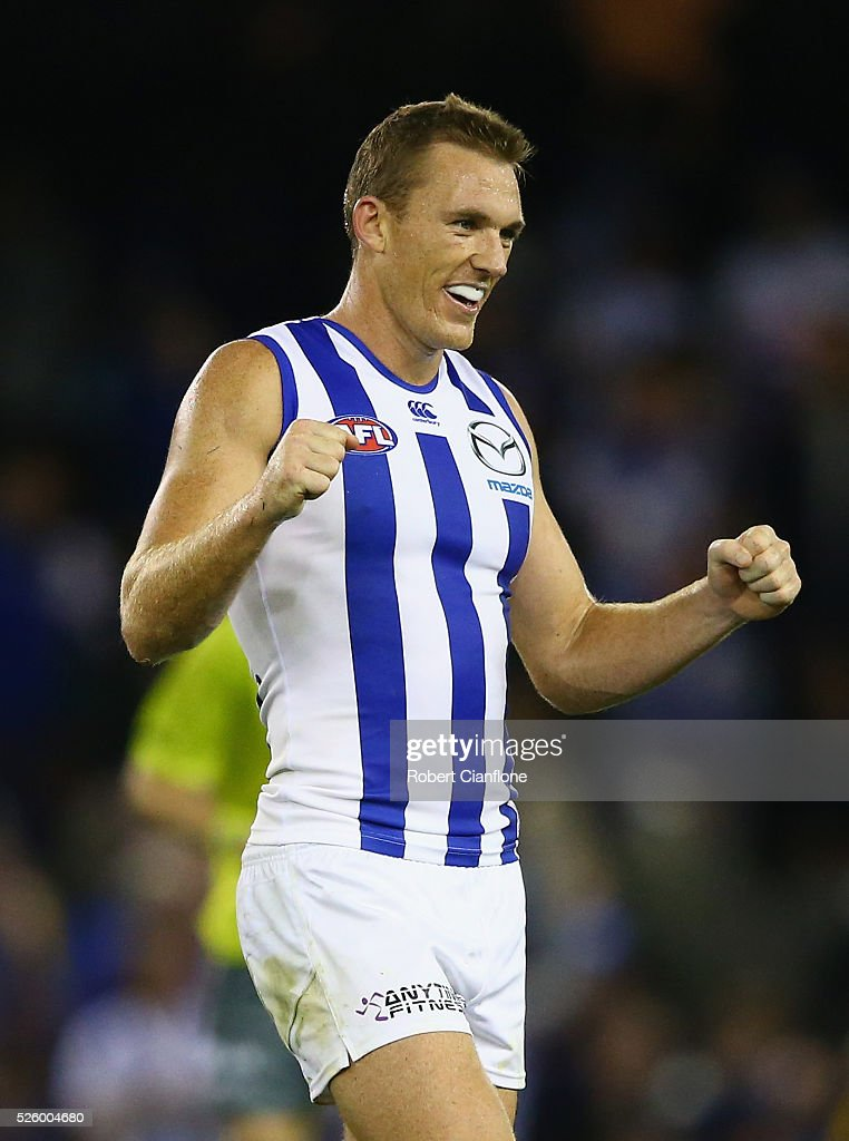 Drew Petrie of the Kangaroos celebrates after the kangaroos defeated the Bulldogs during the round six AFL match between the North Melbourne Kangaroos and the Western Bulldogs at Etihad Stadium on April 29, 2016 in Melbourne, Australia.