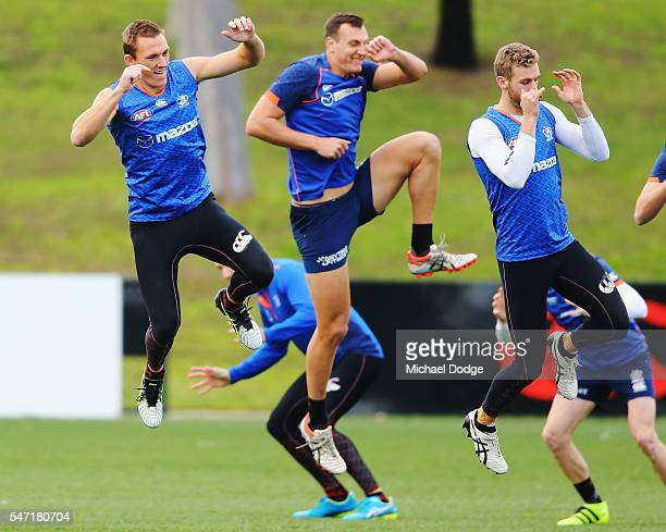 Drew Petrie of the Kangaroos jumps during a warm up drill during a North Melbourne Kangaroos AFL training session at Arden Street Ground on July 14...