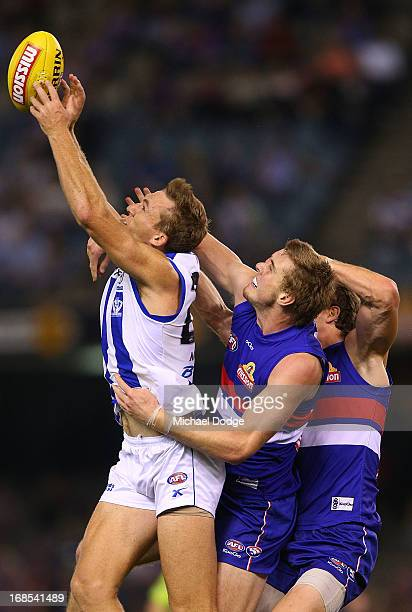 Drew Petrie of the Kangaroos marks the ball against Jordan Roughead of the Bulldogs during the round seven AFL match between the Western Bulldogs and...