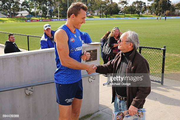 Drew Petrie of the Kangaroos, not to be re-contracted for next season by the club, is wished well by a fan during a North Melbourne Kangaroos AFL...