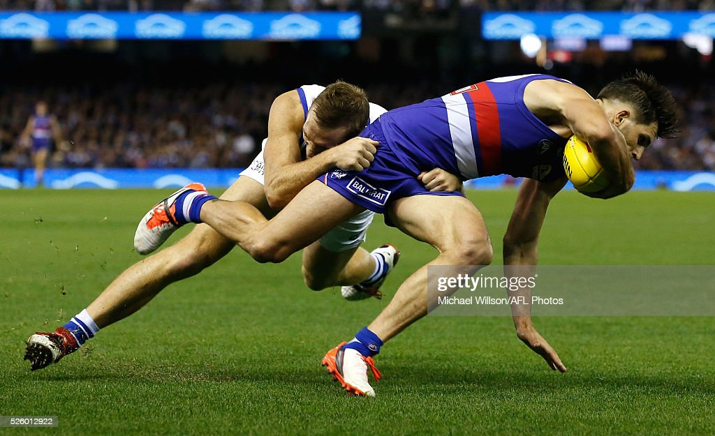 Drew Petrie of the Kangaroos tackles Koby Stevens of the Bulldogs during the 2016 AFL Round 06 match between the North Melbourne Kangaroos and the Western Bulldogs at Etihad Stadium, Melbourne on April 29, 2016.
