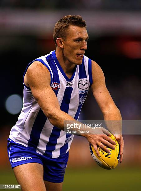 Drew Petrie of the Kangaroos with the ball during the round 15 AFL match between the North Melbourne Kangaroos and the Richmond Tigers at Etihad...