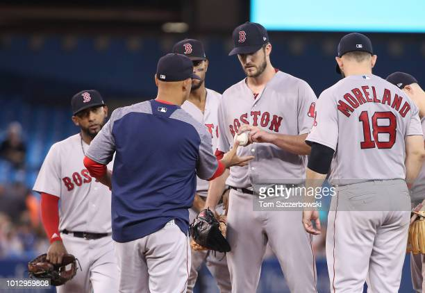 Drew Pomeranz of the Boston Red Sox exits the game as he is relieved by manager Alex Cora in the fifth inning during MLB game action against the...