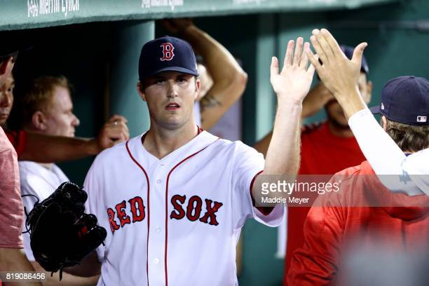 Drew Pomeranz of the Boston Red Sox high fives teammates in the dugout after being relieved during the seventh inning against the Toronto Blue Jays...
