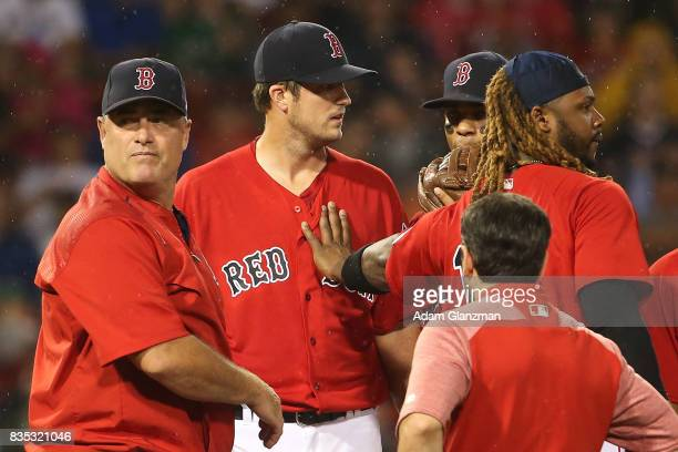 Drew Pomeranz of the Boston Red Sox leaves the game in the fourth inning with an apparent injury during a game against the New York Yankees at Fenway...