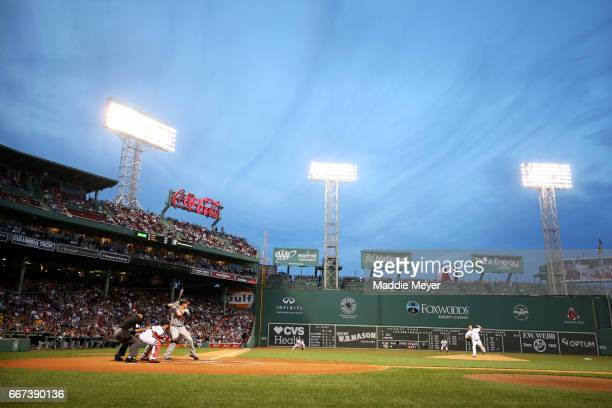 Drew Pomeranz of the Boston Red Sox pitches to Mark Trumbo of the Baltimore Orioles during the first inning at Fenway Park on April 11, 2017 in...