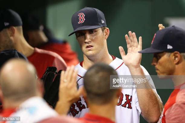 Drew Pomeranz of the Boston Red Sox returns to the dugout after being pulled in the seventh inning of a game against the Chicago White Sox at Fenway...