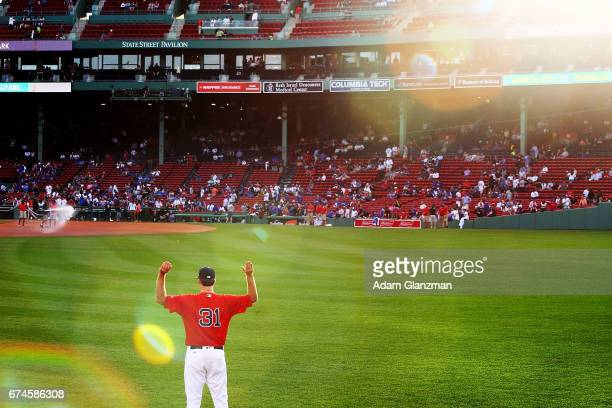 Drew Pomeranz of the Boston Red Sox warms up in the outfield before a game against the Chicago Cubs at Fenway Park on April 28 2017 in Boston...