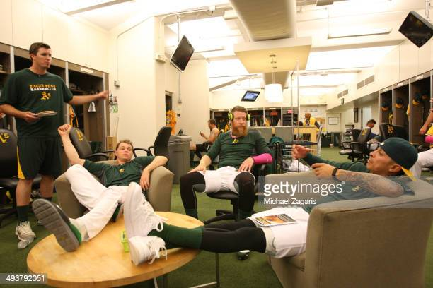 Drew Pomeranz Sonny Gray Sean Doolittle and Jesse Chavez of the Oakland Athletics relax in the clubhouse prior to the game against the Washington...