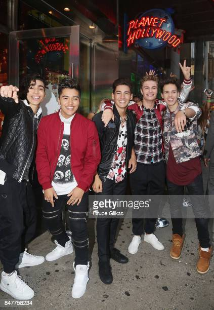 Drew Ramos Sergio Calderon Chance Perez Brady Tutton and Michael Conor of the group 'In Real Life' the grand prize winner of ABC's 'Boy Band' visit...