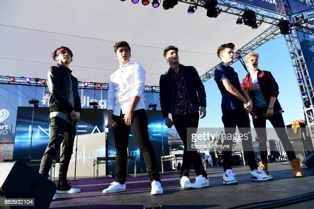 Drew Ramos Sergio Calderon Chance Perez Michael Conor and Brady Tutton of In Real Life perform on stage at 1027 KIIS FM's Jingle Ball Village at KIIS...