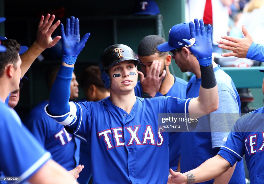 Drew Robinson #18 of the Texas Rangers is congratulated for hitting a hits a solo home run home run in the eighth inning against the Houston Astros at Globe Life Park in Arlington on April 1, 2018 in Arlington, Texas.