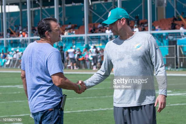 Drew Rosenhaus greets head coach Adam Gase of the Miami Dolphins during Miami Dolphins Training Camp at Baptist Health Training Facility at Nova...