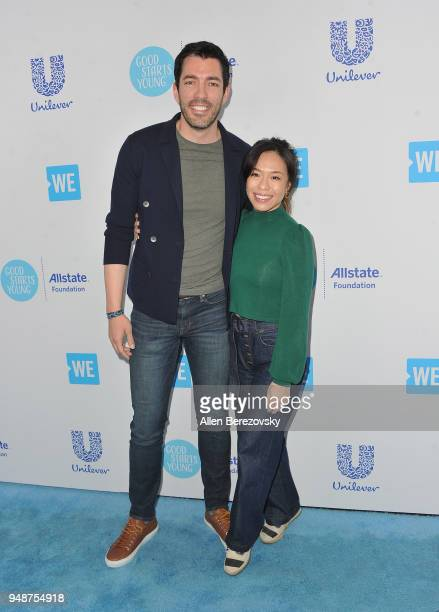 Drew Scott and Linda Phan attend WE Day California at The Forum on April 19 2018 in Inglewood California