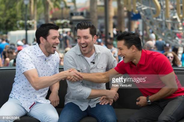 "Drew Scott, Jonathan Scott and Mario Lopez visit ""Extra"" at Universal Studios Hollywood on July 17, 2017 in Universal City, California."
