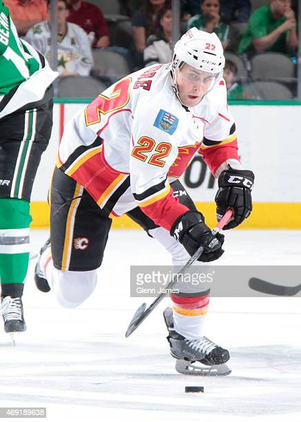 Drew Shore of the Calgary Flames handles the puck against the Dallas Stars at the American Airlines Center on March 30 2015 in Dallas Texas