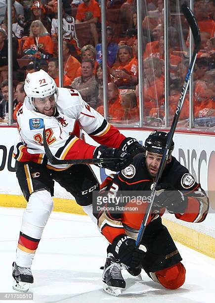 Drew Shore of the Calgary Flames knocks Clayton Stoner of the Anaheim Ducks to the ice during the second period in Game One of the Western Conference...