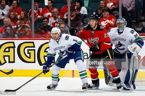 Drew Shore of the Calgary Flames skates against Chris Tanev of the Vancouver Canucks during an NHL game on April 7 2016 at the Scotiabank Saddledome...