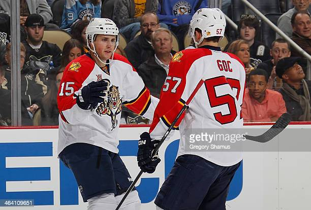 Drew Shore of the Florida Panthers celebrates his shorthanded goal with Marcel Goc during the first period against the Pittsburgh Penguins on January...