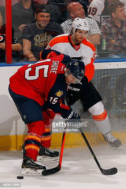 Drew Shore of the Florida Panthers crosses sticks with Braydon Coburn of the Philadelphia Flyers at the BBT Center on April 8 2014 in Sunrise Florida