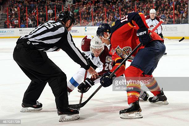 Drew Shore of the Florida Panthers faces off against Paul Stastny of the Colorado Avalanche at the BBT Center on January 24th 2014 in Sunrise Florida