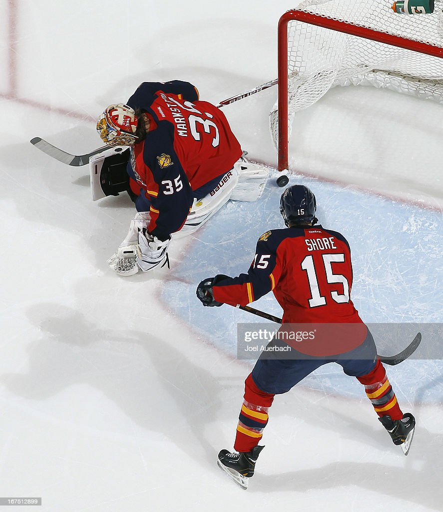 Drew Shore #15 of the Florida Panthers looks on as the puck shot by Leo Komarov (not pictured) of the Toronto Maple Leafs scores under the legs of goaltender Jacob Markstrom #35 at the BB&T Center on April 25, 2013 in Sunrise, Florida. The Maple Leafs defeated the Panthers 4-0.