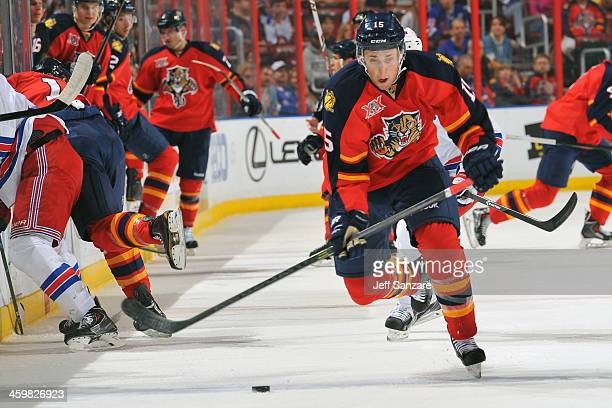 Drew Shore of the Florida Panthers skates for possession against the New York Rangers at the BBT Center on December 31 2013 in Sunrise Florida
