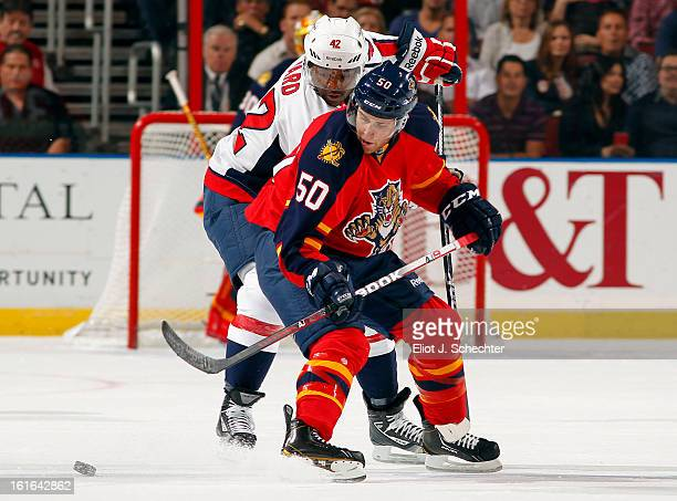 Drew Shore of the Florida Panthers tangles with Joel Ward of the Washington Capitals at the BBT Center on February 12 2013 in Sunrise Florida