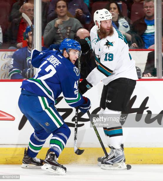 Drew Shore of the Vancouver Canucks and Joe Thornton of the San Jose Sharks watch the play during their NHL game at Rogers Arena April 2 2017 in...