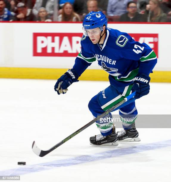 Drew Shore of the Vancouver Canucks skates up ice with the puck during their NHL game against the Los Angeles Kings at Rogers Arena March 31 2017 in...