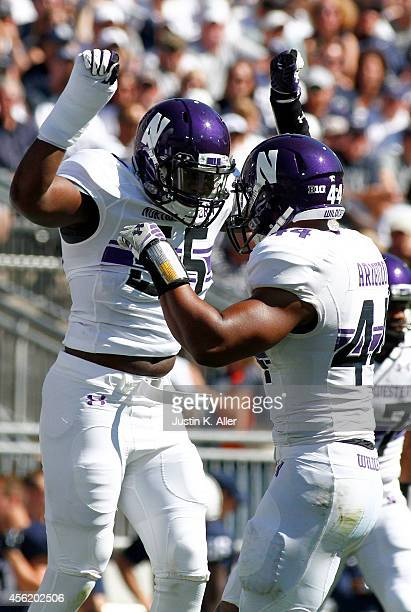 Drew Smith of the Northwestern Wildcats celebrates with Chi Chi Ariguzo after sacking the quarterback in the first half against the Penn State...