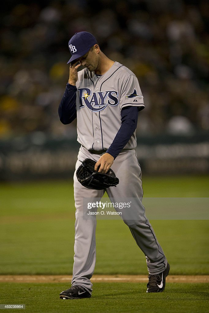 Drew Smyly #33 of the Tampa Bay Rays returns to the dugout after being relieved against the Oakland Athletics during the sixth inning at O.co Coliseum on August 5, 2014 in Oakland, California.