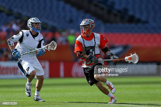 Drew Snider of the Denver Outlaws in action against the Ohio Machine at Sports Authority Field at Mile High on May 4 2014 in Denver Colorado The...