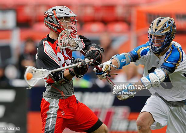 Drew Snider of the Denver Outlaws takes a shot against Kevin Drew of the Charlotte Hounds at Sports Authority Field at Mile High on May 3 2015 in...
