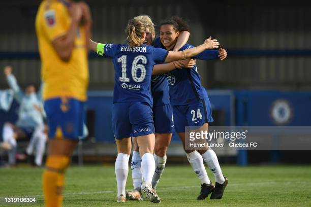 Drew Spence of Chelsea celebrates with teammates Magdalena Eriksson and Millie Bright after scoring her team's third goal during the Vitality Women's...
