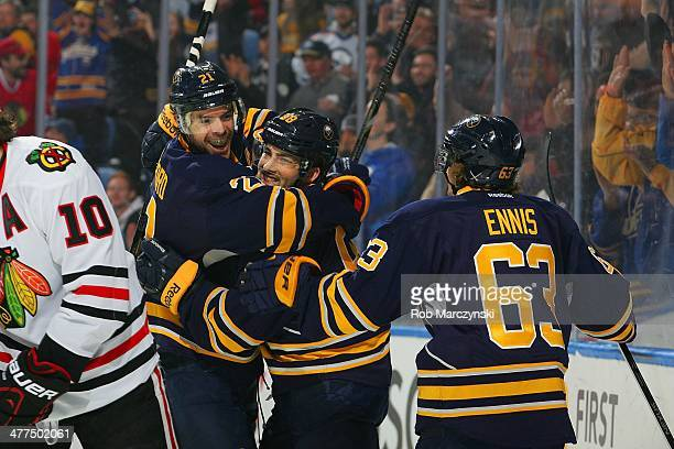 Drew Stafford of the Buffalo Sabres celebrates his first period goal against the Chicago Blackhawks with teammates Cory Conacher and Tyler Ennis on...