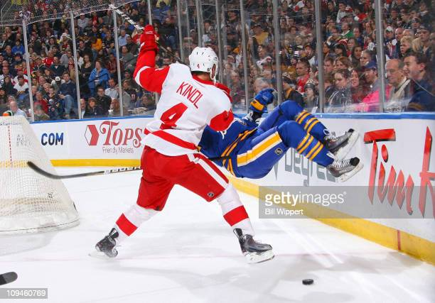 Drew Stafford of the Buffalo Sabres is upended behind the net by Jakub Kindl of the Detroit Red Wings at HSBC Arena on February 26 2011 in Buffalo...