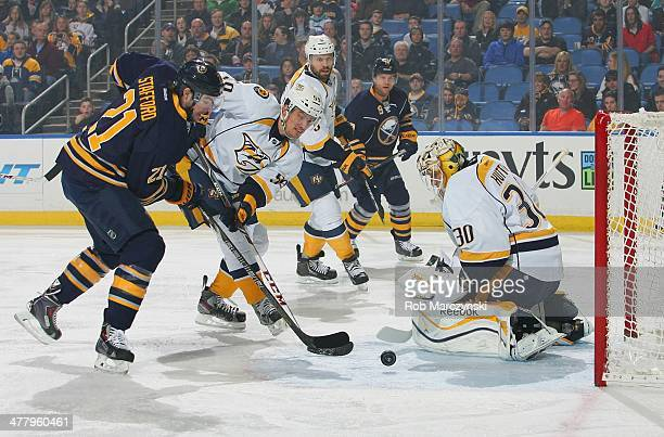 Drew Stafford of the Buffalo Sabres scores a first period goal against Carter Hutton and Roman Jost of the Nashville Predators It was Stafford's...