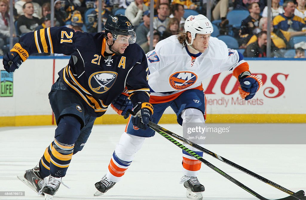 Drew Stafford #21 of the Buffalo Sabres skates against Matt Martin #17 of the New York Islanders at First Niagara Center on April 13, 2014 in Buffalo, New York. New York defeated Buffalo 4-3.