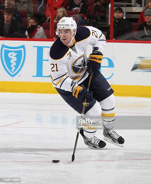 Drew Stafford of the Buffalo Sabres skates with the puck during an NHL game against the Carolina Hurricanes on November 18 2011 at RBC Center in...